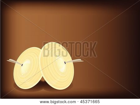 A Beautiful Cymbal On Dark Brown Background