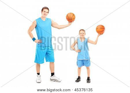 Full length portrait of a basketball players posing isolated on white background