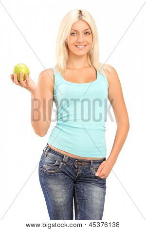 A studio shot of a blond smiling woman holding a green apple and looking at camera isolated on white background