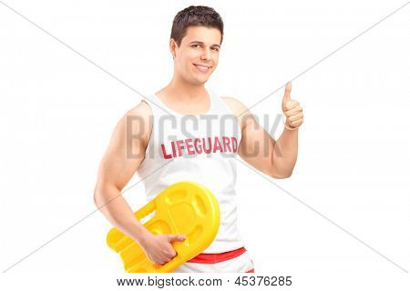 A happy lifeguard on duty giving a thumb up isolated on white background