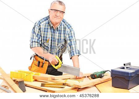 Middle aged male carpenter working in a workshop isolated on white background