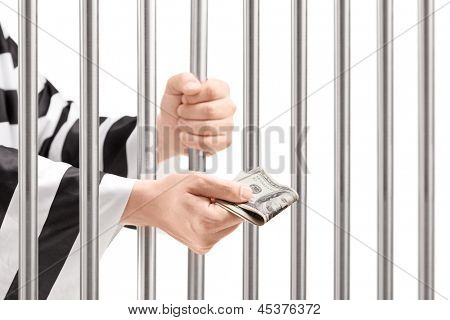 Man in jail holding prison bars and giving bribe isolated on white background