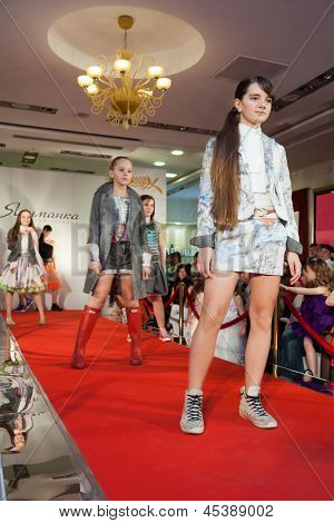 MOSCOW - MAR 18: The several girls on the runway at a fashion show in a childrens store Jakimanka on March 18, 2012 in Moscow, Russia.