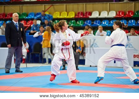 MOSCOW - JUN 9: Fighting episode between female participants of 10th Team Championship of Europe on karate at OC Luzhniki, Small sports arena, June 9, 2012, Moscow, Russia.