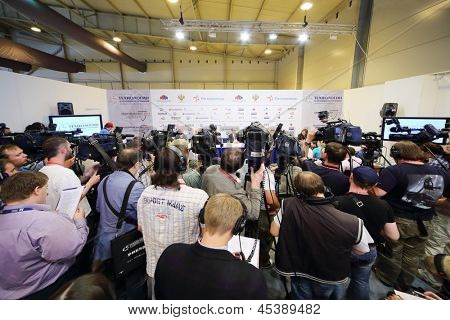 ZHUKOVSKY - JUNE 25: Photographers and journalists at press conference at second International Forum Engineering Technologies 2012, on June 25, 2012 in Zhukovsky near Moscow, Russia.