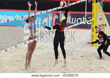 MOSCOW - JUNE 6: Female athletes from Brazil play volleyball in Country Quota at tournament Grand Slam of beach volleyball 2012, on June 6, 2012 in Moscow, Russia.