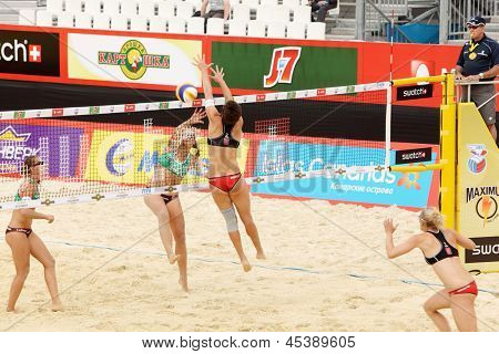 MOSCOW - JUNE 6: Teams from Germany play volleyball in Country Quota at tournament Grand Slam of beach volleyball 2012, on June 6, 2012 in Moscow, Russia.