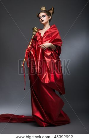 Middle Ages. Magic. Lordly Woman Wizard In Red Pallium With Scepter. Witchcraft