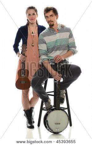 Young couple holding ucalaly and banjo isolated over white background