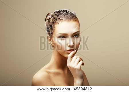 Fantasy. Creative Concept. Tarantula Spider On Woman's Head Sitting In Metallic Cobweb