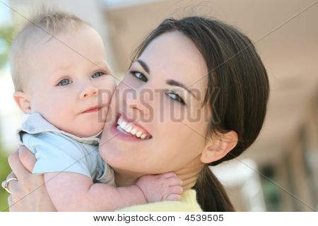 Adorable Blue Eyed Baby Boy With Mom