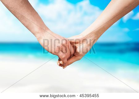 Holding Hands Couple On Beach