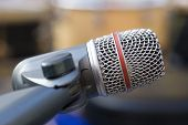 stock photo of emcee  - Professional recording microphone on shock mount whit blurred background