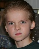 image of yucky  - head shot of a boy with a sneering expression - JPG