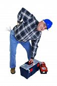 foto of spinal disks  - Workman with backache lifting the toolbox isolated on white - JPG