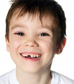 image of toothless smile  - Portrait of a smiling toothless boy on white background - JPG