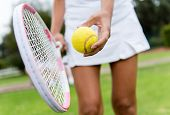 picture of clos  - Close up of a tennis player hitting the ball with racket - JPG