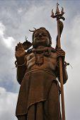 pic of brahma  - marble wood gold statue of a Hinduism Shiva vishnu Brahma in a temple near a lake in mauritius africa  - JPG