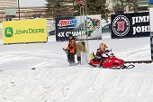 Tiny Polaris Red Snowmobile Starting To Race