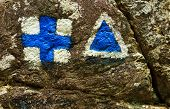Hiking trail signs symbols painted on a rock