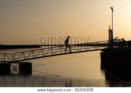 Bridge With Man In Sunset
