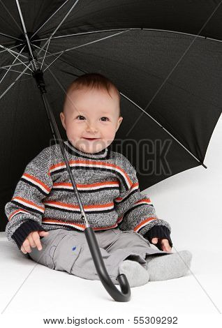 Baby Boy Sitting Under Umbrella