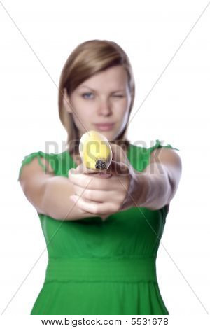 Girl Holds Banana As A Gun
