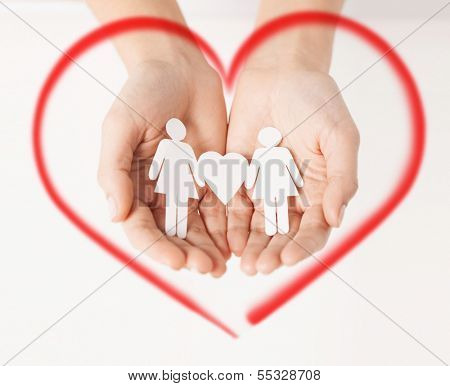 love, family and happiness concept - womans hands showing two paper women with heart shape