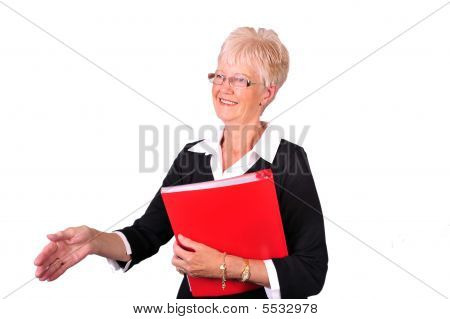 Senior/mature Business Woman About To Shake Hands