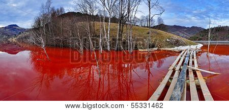 Environmental Disaster. Panorama Of A Lake Full With Contaminated Water From A Mine In Geamana, Rosi
