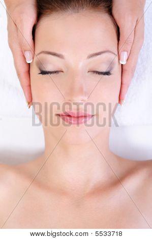 Woman Getting Face Massage In Spa Salon