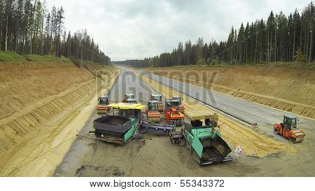 Empty machines on road construction. View from unmanned quadrocopter.