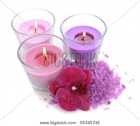Beautiful colorful candles, orchid flower, sea salt isolated on white