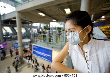 With Flu Mask At The Airport