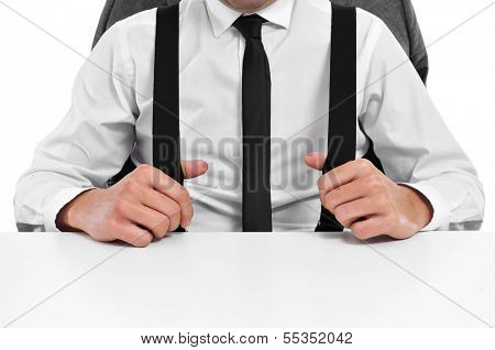 a businessman with suspenders sitting in a desk in the office