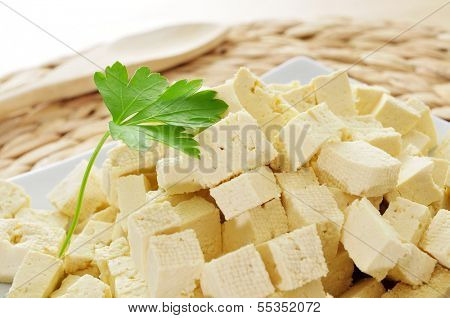 diced tofu in a plate, on a worktop