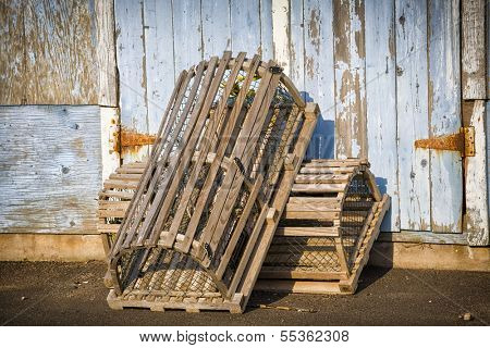 Lobster traps propped up on a wharf in rural Prince Edward Island, Canada.
