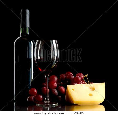 Bottle Of Wine, A Bunch Of Red Grapes And A Piece Of Cheese