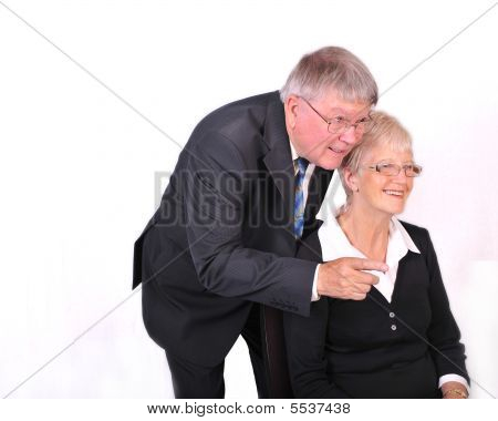 Mature Businessman With Secretary Possibly Looking At Computer Screen
