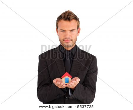 Young Businessman Presenting A Sample Of House