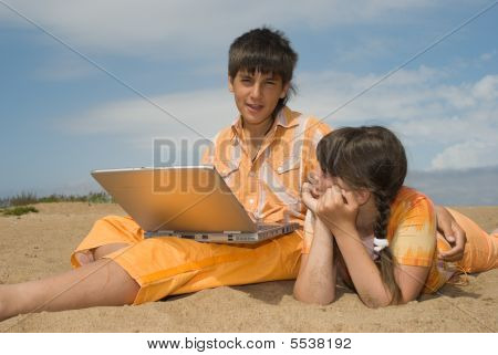 Two Teens  With Laptops
