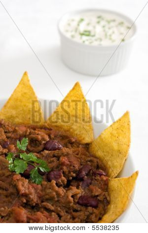 Chili Con Carne With Tortilla Chips On A White Background
