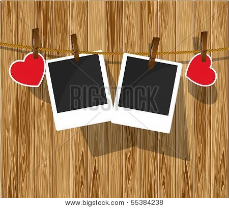 Photo frames on wood background.