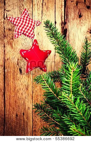 Beautiful Old Fashioned Christmas Ornaments  On Wooden Board With Fir Tree Branch And Festive Decora