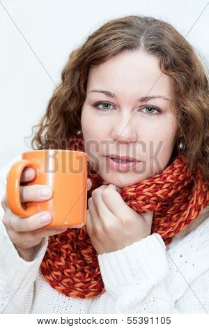 Caught A Cold Woman With A Hot Cup Of Tea In Hands