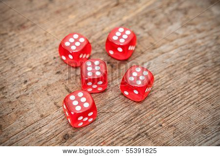 Six Numbers On Faces Of Five Red Dices On Wooden Floor