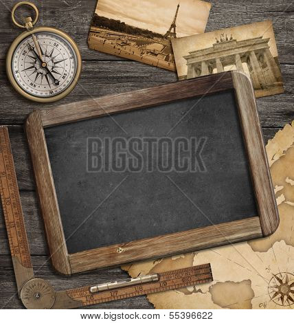 adventure nautical background with vintage treasure map, blackboard and compass