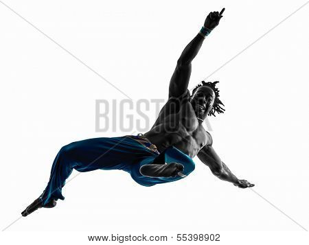 one man capoeira dancer dancing silhouette studio isolated on white background