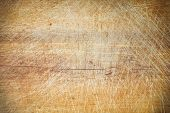 foto of cut  - Old grunge wooden cutting kitchen desk board background texture - JPG