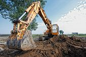 picture of excavator  - excavator digging a trench for the pipeline - JPG